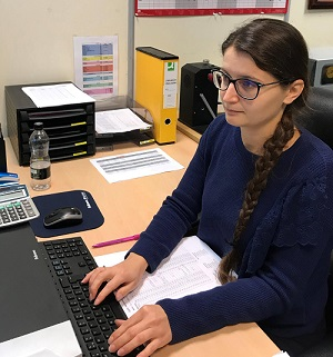 P3 Medical's apprentice typing on a keyboard at her desk