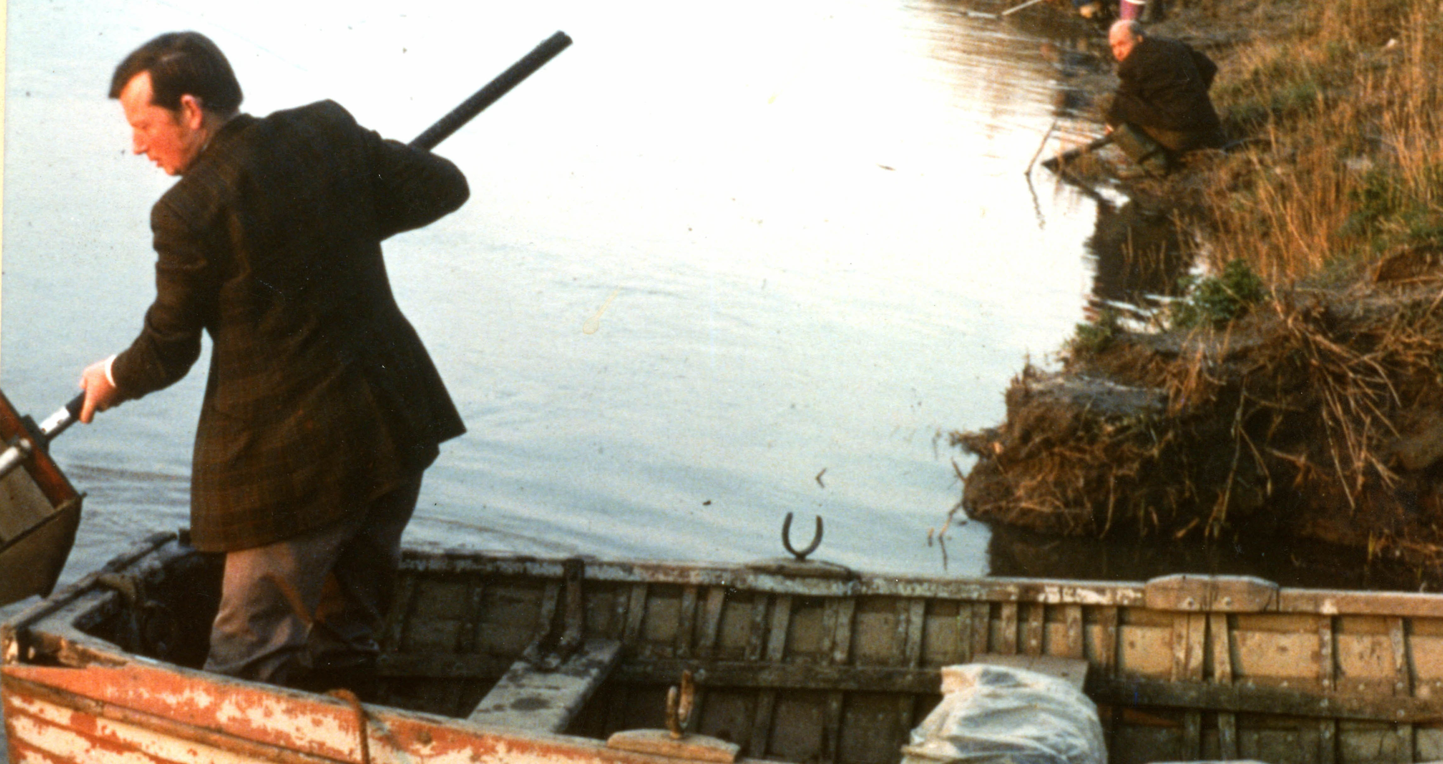 A fisherman catching eels