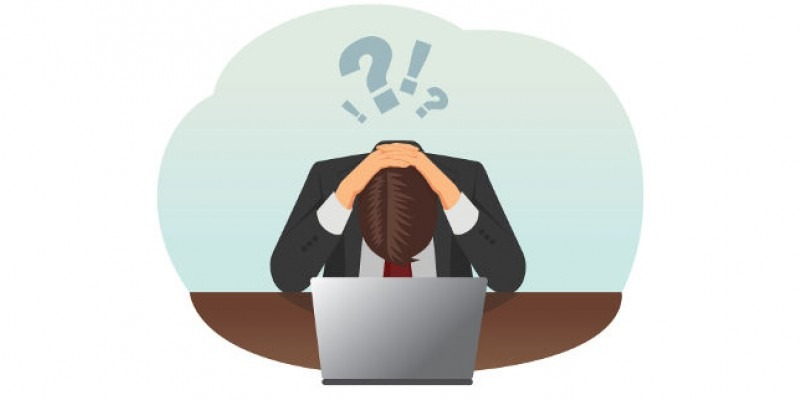 Social Media Mistakes - Person with their head in their hands over a laptop.
