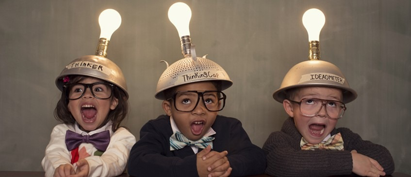 Intellectual property advice with children wearing glasses and sieves/bowls on their heads. There are lightbulbs on top of the sieves/bowls which are on representing an idea.