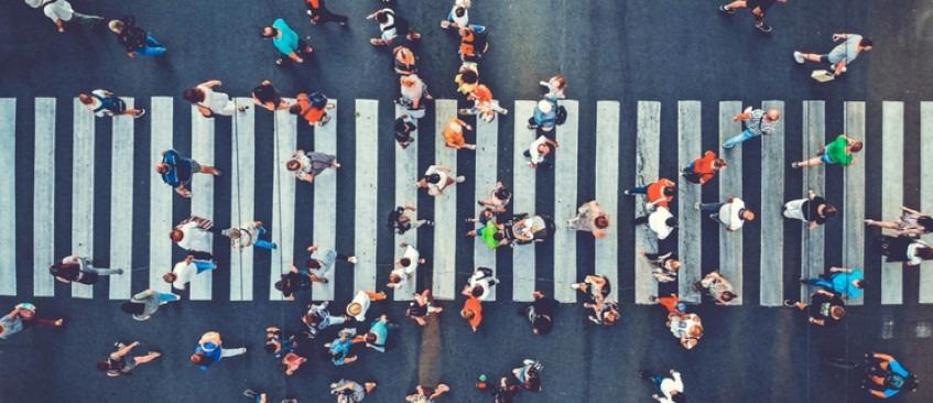 People walking over crossing