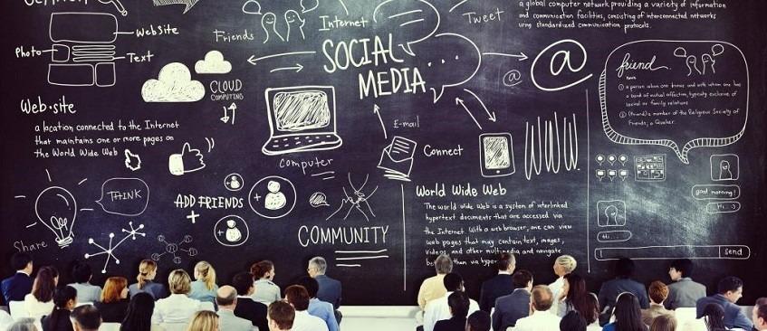 Business people attending social media workshop