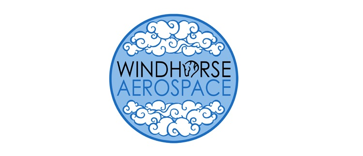 Windhorse Aerospace logo in a blue circle with the words windhorse in black and aerospace in a different blue. The circle also has clouds above and below the words and the letter o in windhorse has a horse head instead